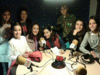 girls next to the microphones of a radio studio