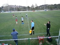 Children playing soccer while their coach is surprised