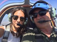 Pilota e passeggero sull'aereo