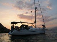 Sailboat while the sun falls