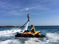 Flyboard next to the jet ski with pilot