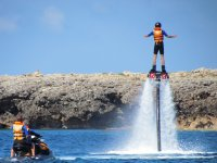 Flyboard next to the instructor on motorcycle