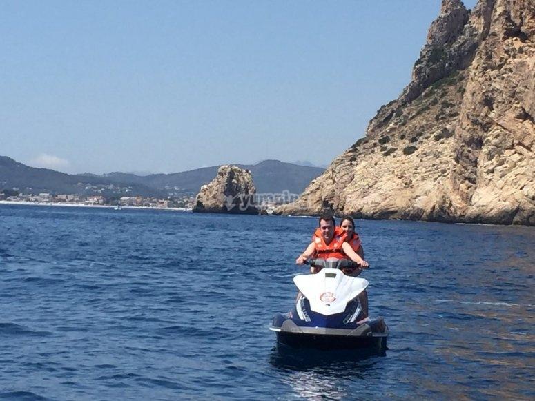 Coples riding a jet ski