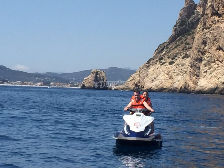 Riding on jet ski along the coast of Alicante