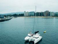 Yacht and catamaran together at anchor