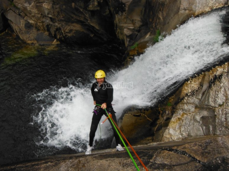 Descending down the waterfall using the ropes