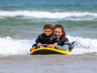 Our very young surfer with the teacher on the board