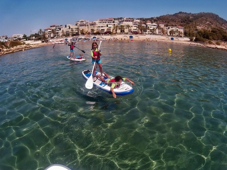 Paddle surf on clear waters