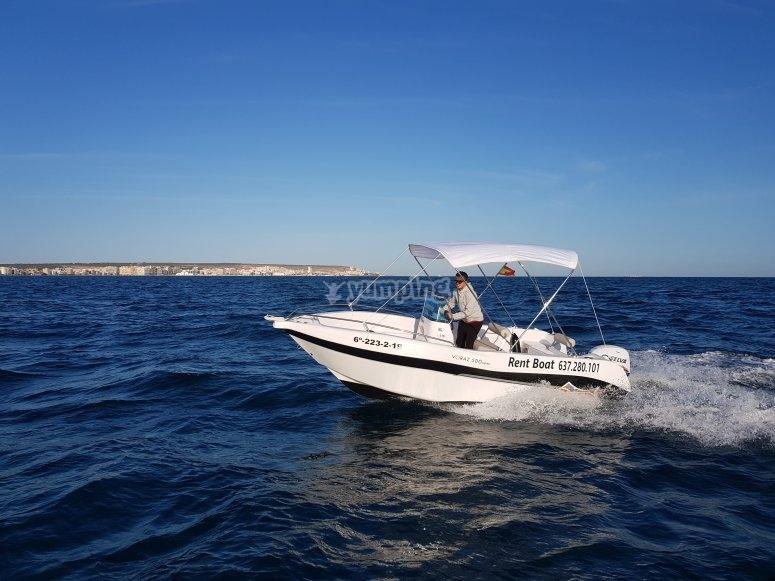 Driving a boat in Alicante