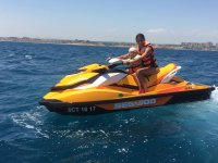 Mother and daughter sailing in Cabo Roing with jet ski