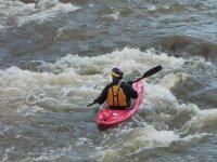 Canoe in fast water