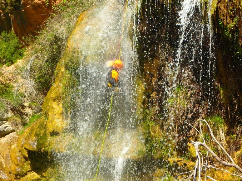 Rappelling in the waterfall