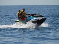 Father and child on a jet ski