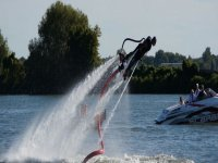 Man about to enter the water while practicing flyboard