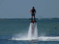 Man practicing flyboard in the water