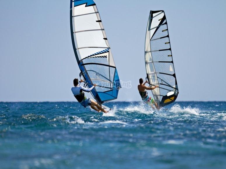 Practising windsurfing