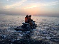 Riding a jet ski at sunset