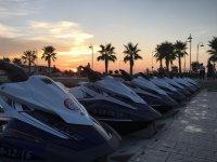 Jet skis at sunset