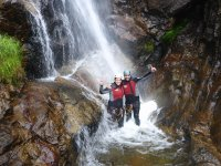 Friends doing canyoning