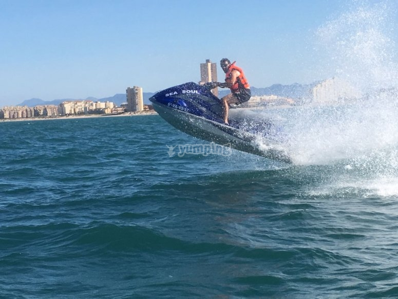 Drive a jet ski in the coast