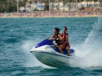 A pair of girls on a jet ski