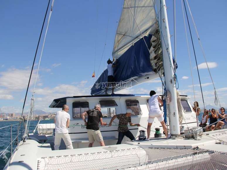 Group on board of the catamaran