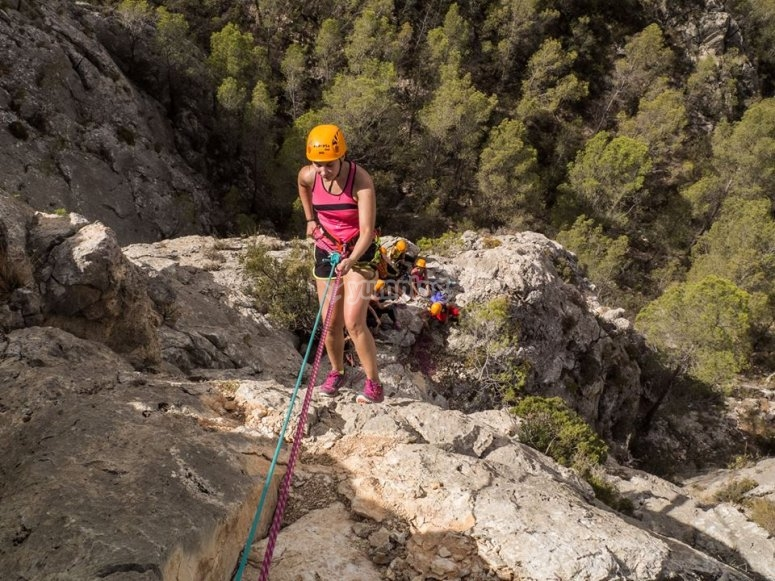 Abseiling down the rocks