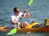 Yellow kayak at sea
