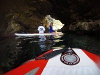 Entering the cave with sup boards