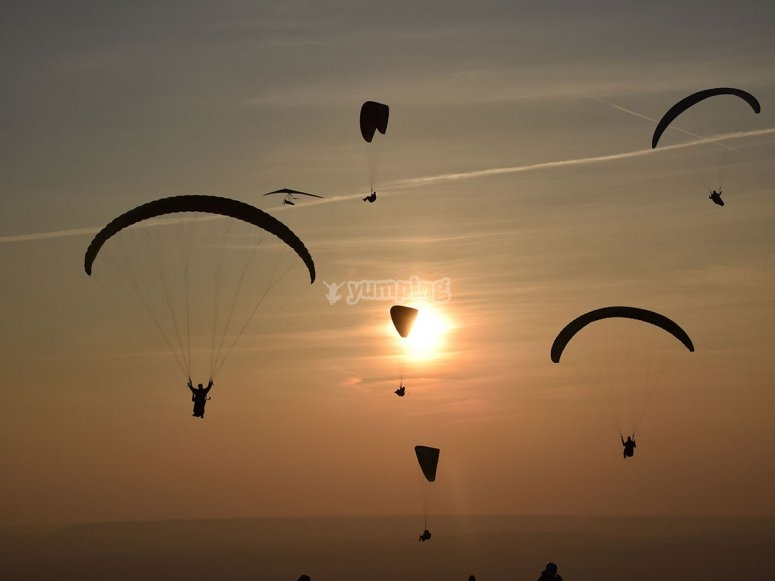 Paragliders at sunset