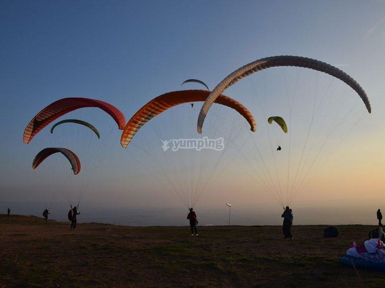 Paragliders mid-flight