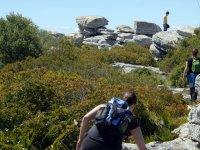 climbing between rocks