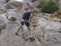 Vertical wall rappelling