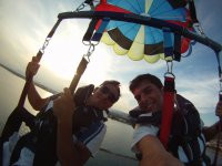 self-picture of two people with parachute