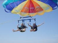 two people enjoying a flight of parascending