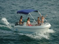 family in a small boat with awning