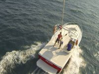 aerial view of a boat on the high seas
