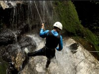 Rappelling under the waterfalls