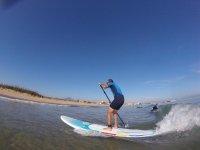 Remando junto a la ola