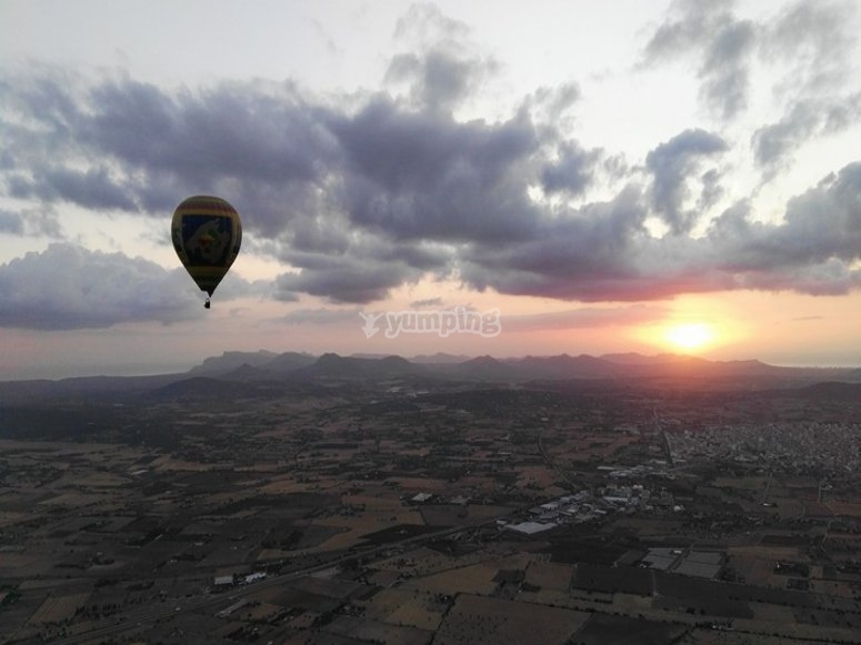 Flying over the fileds at sunset