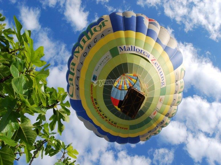 A hot-air balloon from below