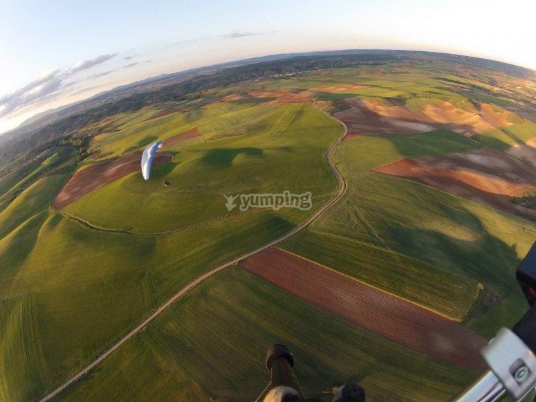 Flying over green fields