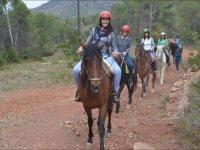 Girls riding together on horseback