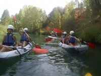 Canoes by groups on the river