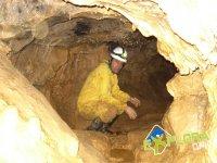 Recent speleologist with yellow monkey