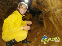 Crouching inside the cave