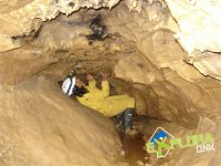 Looking at the low ceiling of the cave