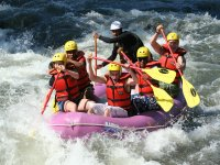 Friends enjoying rafting in Sevilla