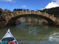 Passing under the bridge with the canoes