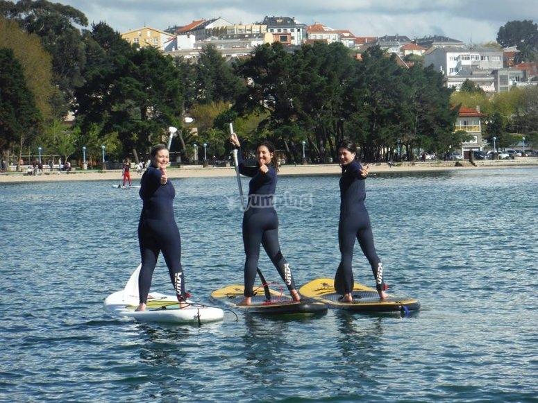 Girls paddle surfing